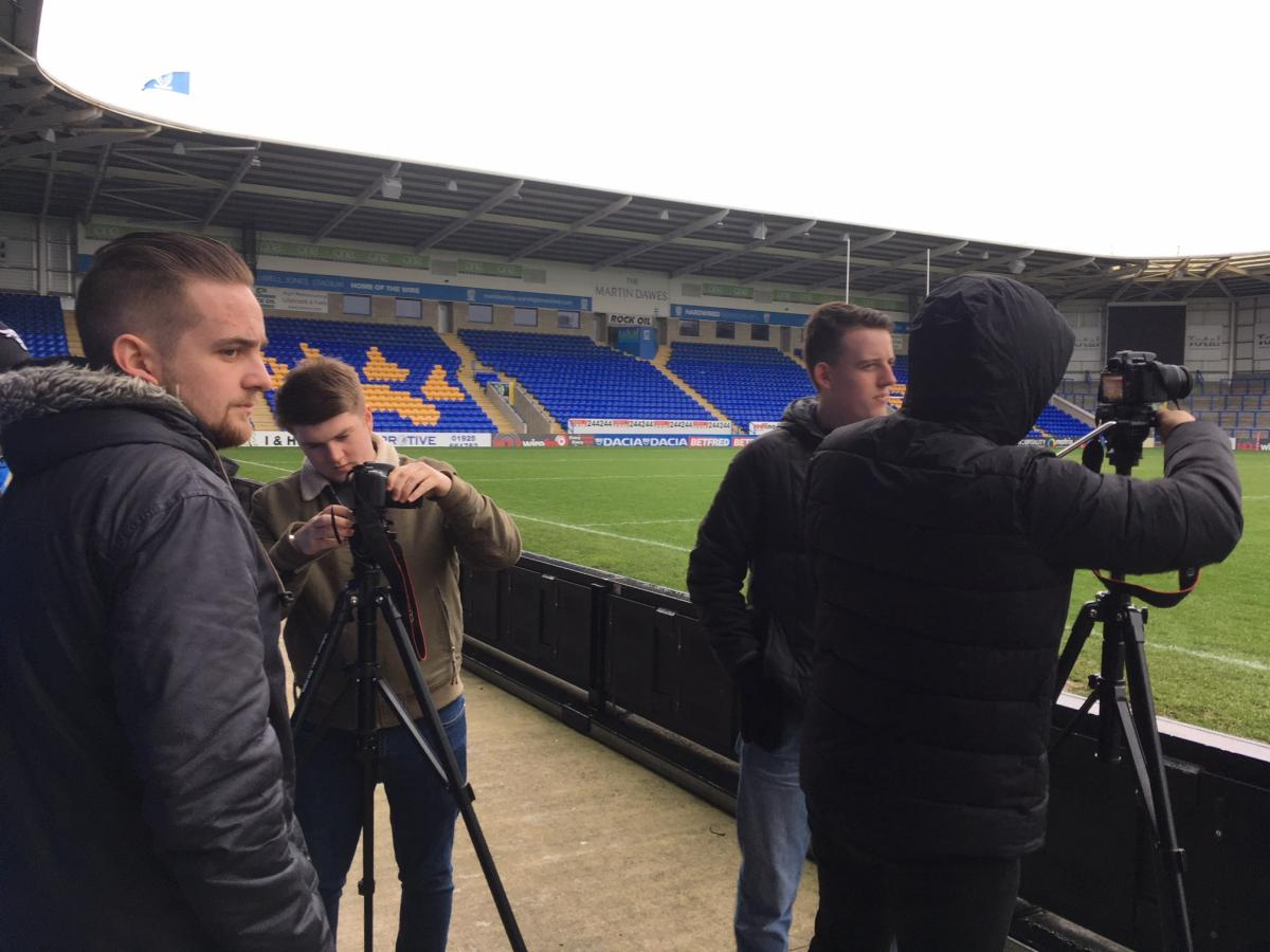Sports Journalism students filming training at The Halliwell Jones Stadium