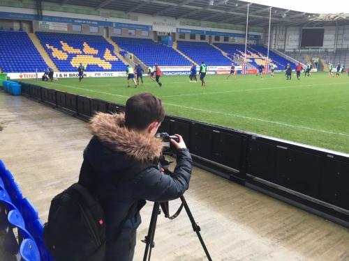Sports Journalism students filming training at The Halliwell Jones Stadium