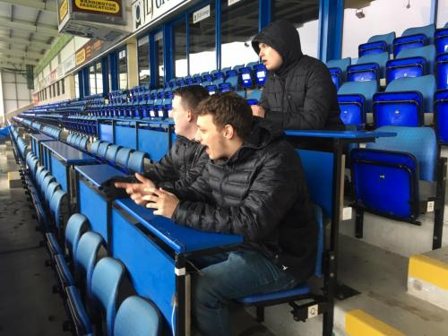 Sports Journalism students watch training from the press area at The Halliwell Jones Stadium